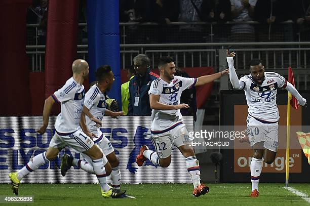 Lyon's French forward Alexandre Lacazette celebrates with teammates after scoring a goal during the French L1 football match between Lyon and...