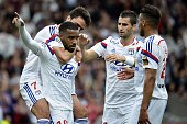Lyon's French forward Alexandre Lacazette celebrates with teammtes after scoring a goal during the French L1 football match between Lyon and Evian on...