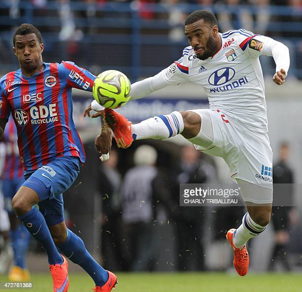 Lyon's French forward Alexandre Lacazette controls the ball next to Caen's French Beninese defender Emmanuel Imoroue during the French L1 football...
