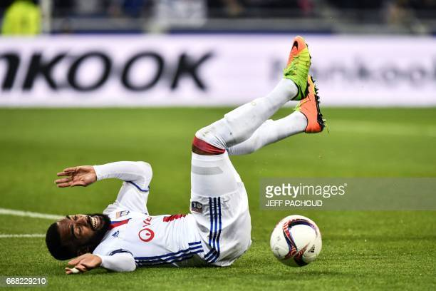 Lyon's French forward Alexandre Lacazette falls after being tackeld by Besiktas' goalkeeper during the UEFA Europa League first leg quarter final...