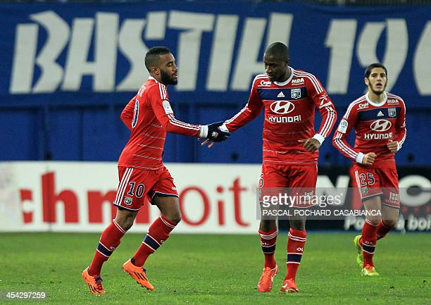 Lyon's French forward Alexandre Lacazette is congratulated by teammates after scoring a goal during the French L1 football match Bastia against Lyon...