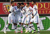 Lyon's French forward Alexandre Lacazette is congratulated by teammates after scoring during the French L1 football match Lens vs Olympique Lyonnais...