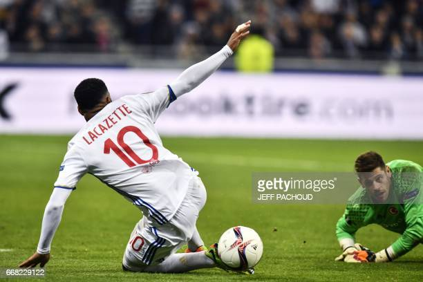 Lyon's French forward Alexandre Lacazette is tackled by Besiktas' Spanish goalkeeper Fabricio Agosto Ramirez during the UEFA Europa League first leg...