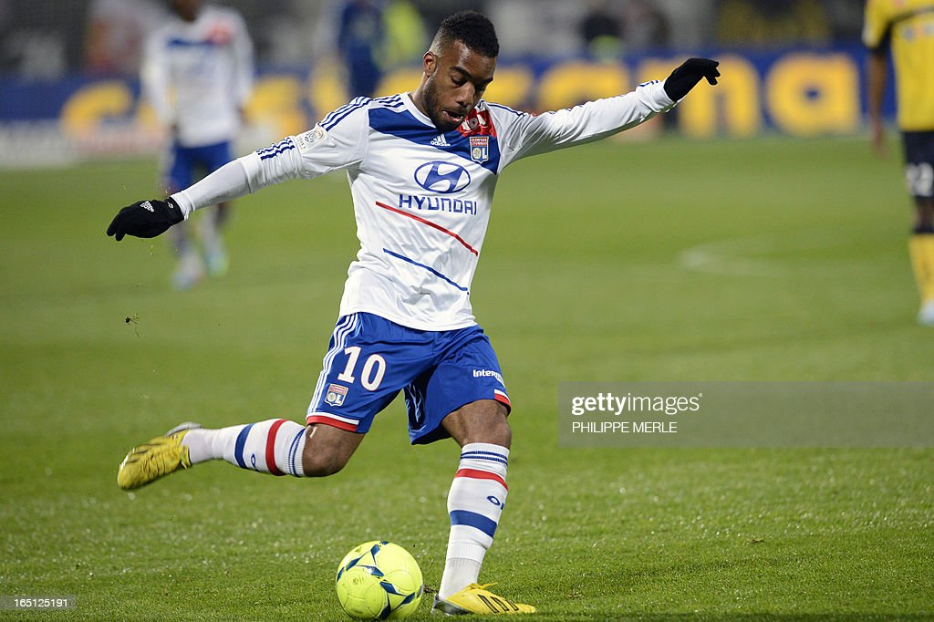 Lyon's French forward Alexandre Lacazette kicks the ball during the French L1 football match Lyon vs Sochaux on March 31, 2013 at the Gerland stadium in Lyon.