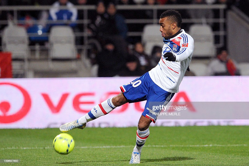 Lyon's French forward Alexandre Lacazette kicks the ball with Lyon's Brazilian midfielder Michel Fernandes Bastos during the French L1 football match between Lyon and Evian on January 18, 2013, at the Gerland stadium in Lyon. AFP PHOTO / PHILIPPE MERLE