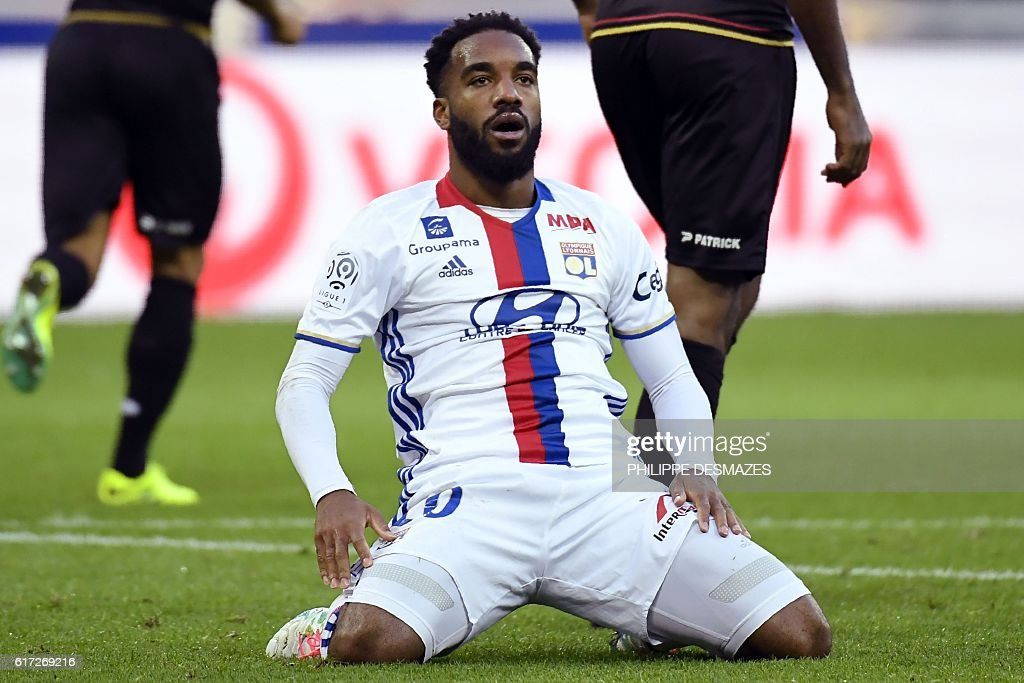 Lyon's French forward Alexandre Lacazette reacts after losing a goal during the French L1 football match between Olympique Lyonnais and EA Guingamp on October 22, 2016, at the Parc Olympique Lyonnais in Decines-Charpieu near Lyon, southeastern France. / AFP / PHILIPPE