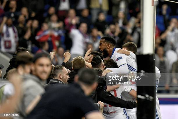 Lyon's French forward Alexandre Lacazette reacts after Lyon's French midfielder Corentin Tolisso scored a goal during the UEFA Europa League first...