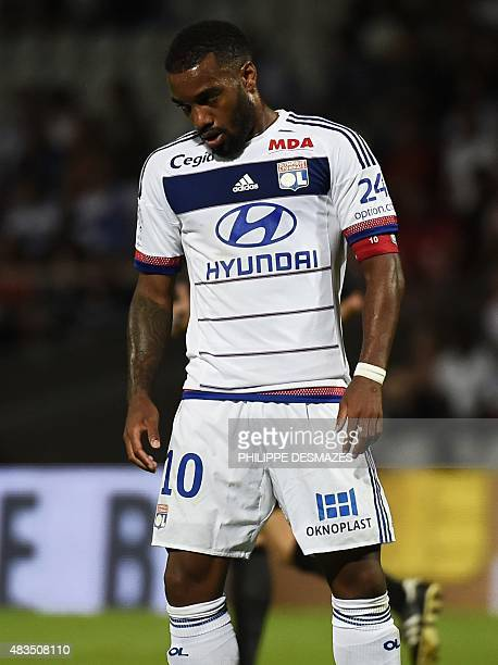 Lyon's French forward Alexandre Lacazette reacts after missing a goal during the French Ligue1 football match between Olympique Lyonnais and FC...