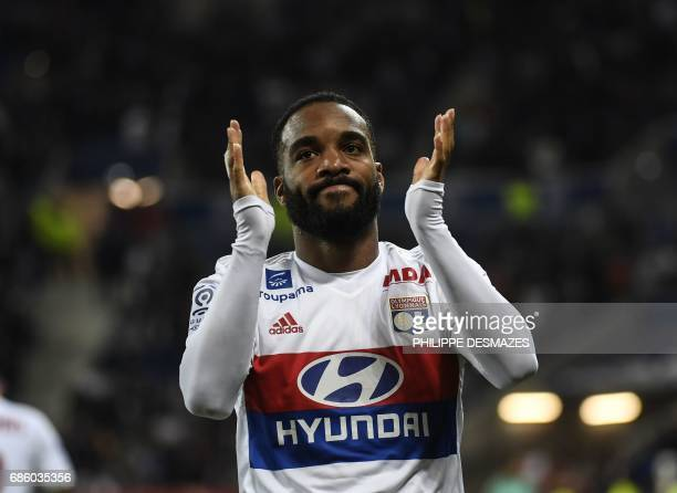 Lyon's French forward Alexandre Lacazette reacts after scoring during the French L1 football match between Lyon and Nice on May 20 at the Parc...
