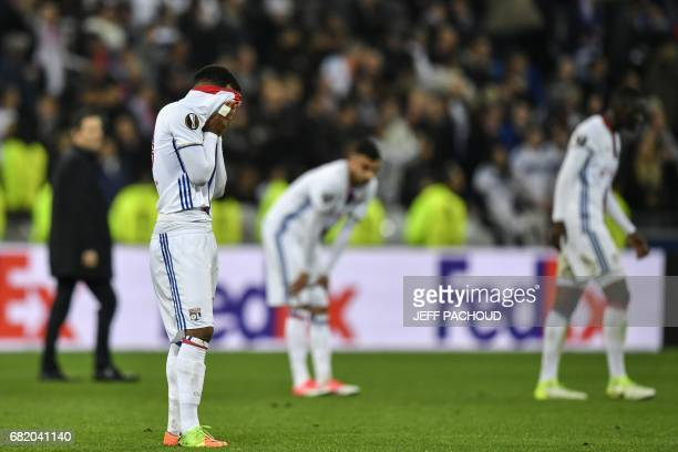 Lyon's French forward Alexandre Lacazette reacts at the end of the Europa League semi final football match Olympique Lyonnais vs Ajax Amsterdam on...
