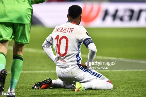 Lyon's French forward Alexandre Lacazette reacts during the UEFA Europa League first leg quarter final football match between Lyon and Besiktas on...