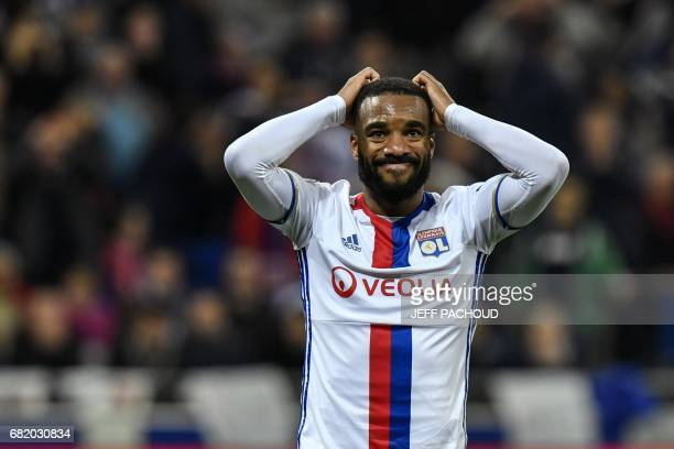 Lyon's French forward Alexandre Lacazette reacts during the UEFA Europa League semifinal football match between Olympique Lyonnais and Ajax Amsterdam...