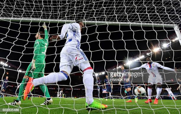 Lyon's French forward Alexandre Lacazette reacts with teammate Lyon's defender Mouctar Diakhaby after scoring the opening goal past Paris...