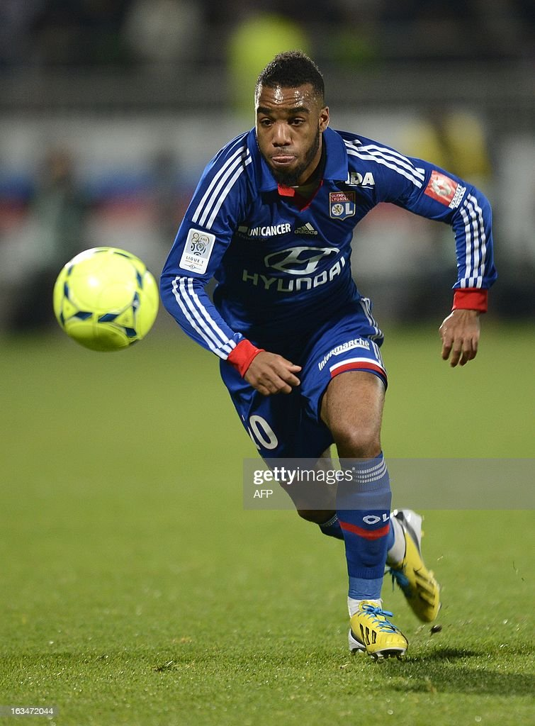Lyon's French forward Alexandre Lacazette runs with the ball during the French L1 football match Olympique Lyonnais (OL) vs Olympique de Marseille (OM) on March 10, 2013 at the Gerland stadium in Lyon, southeasthern France. AFP PHOTO/PHILIPPE DESMAZES