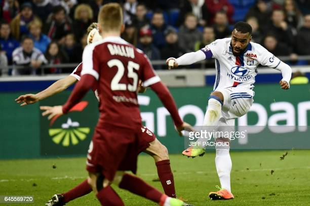 Lyon's French forward Alexandre Lacazette scores a goal during the French L1 football match Olympique Lyonnais vs FC Metz on February 26 at the Parc...