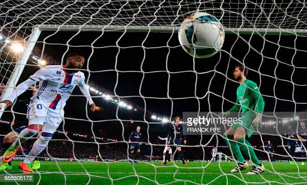 Lyon's French forward Alexandre Lacazette scores the opening goal past Paris SaintGermain's German goalkeeper Kevin Trapp during the French L1...