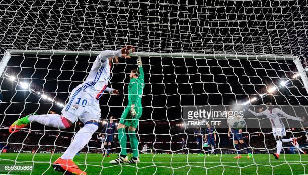 Lyon's French forward Alexandre Lacazette scores the opening goal past Paris SaintGermain's German goalkeeper Kevin Trapp as Lyon's defender Mouctar...