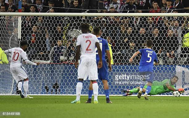 Lyon's French forward Alexandre Lacazette shoots a penalty stoped by Juventus' Italian goalkeeper Gianluigi Buffon during the Champions League...