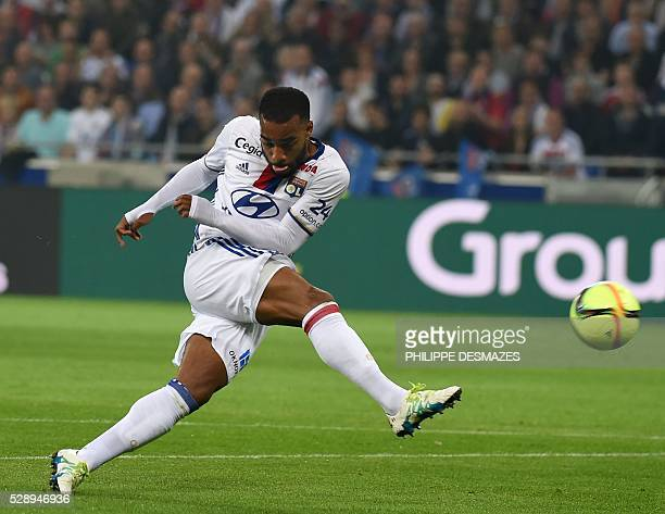 Lyon's French forward Alexandre Lacazette shoots the ball during the French L1 football match Olympique Lyonnais and AS Monaco on May 7 at the New...