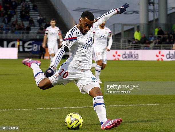 Lyon's French forward Alexandre Lacazette shoots to score during the French L1 football match Lyon vs Toulouse on January 11 2015 at the Gerland...