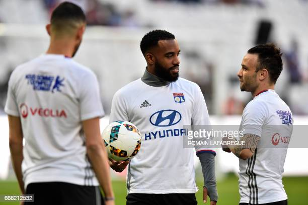 Lyon's French forward Alexandre Lacazette speaks with Lyon's French midfielder Mathieu Valbuena prior to the French L1 football match between...