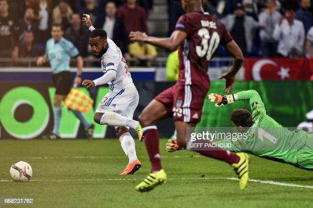 Lyon's French forward Alexandre Lacazette tries to score as Besiktas' Spanish goalkeeper Fabricio Agosto Ramirez dives during the UEFA Europa League...