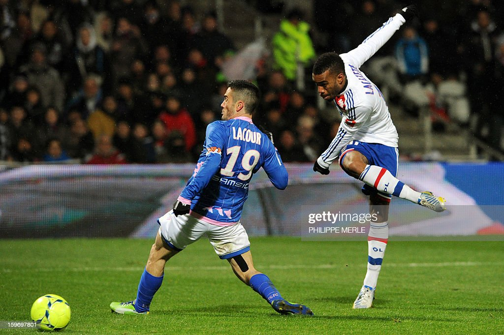Lyon's French forward Alexandre Lacazette (R) vies for the ball with Evian's French midfielder Guillaume Lacour during the French L1 football match between Lyon and Evian on January 18, 2013, at the Gerland stadium in Lyon.