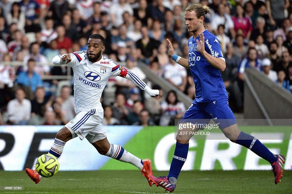 Lyon's French forward <a gi-track='captionPersonalityLinkClicked' href=/galleries/search?phrase=Alexandre+Lacazette&family=editorial&specificpeople=6927653 ng-click='$event.stopPropagation()'>Alexandre Lacazette</a> (L) vies with Bastia's Belgian midfielder <a gi-track='captionPersonalityLinkClicked' href=/galleries/search?phrase=Guillaume+Gillet&family=editorial&specificpeople=4542498 ng-click='$event.stopPropagation()'>Guillaume Gillet</a> (R) during the French L1 football match Olympique Lyonnais (OL) vs FC Bastia (FCB) on April 15, 2015, at the Gerland Stadium in Lyon, central-eastern France.