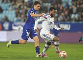 Lyon's French forward Alexandre Lacazette vies with Bastia's French midfielder Yannick Cahuzac during the French L1 football match Bastia against...