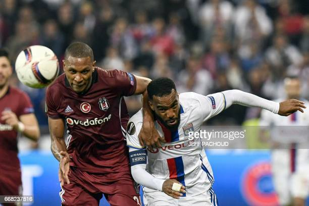 Lyon's French forward Alexandre Lacazette vies with Besiktas' Brasilian defender Marcelo during the UEFA Europa League first leg quarter final...