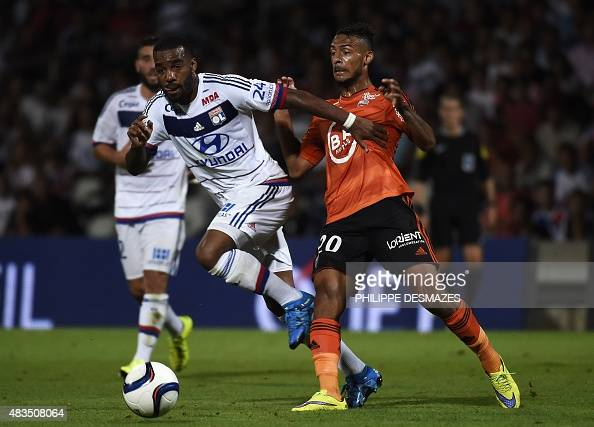 Lyon's French forward Alexandre Lacazette vies with Lorient's French midfielder Denis Bouanga during the French Ligue1 football match between...