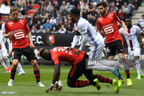 Lyon's French forward Alexandre Lacazette vies with Rennes' French defender Joris Gnagnon during the French L1 football match between Rennes and Lyon...