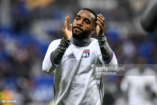 Lyon's French forward Alexandre Lacazette warms up prior to the Europa League semifinal football match Olympique Lyonnais versus Ajax Amsterdam on...