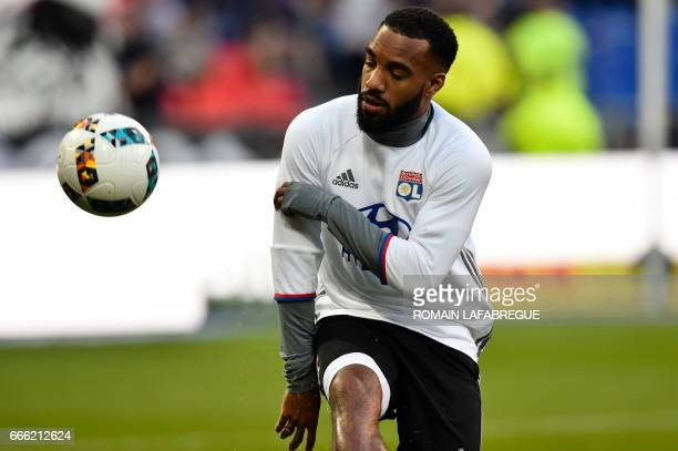 Lyon's French forward Alexandre Lacazette warms up prior to the French L1 football match between Olympique Lyonnais and Lorient on April 8 at the...