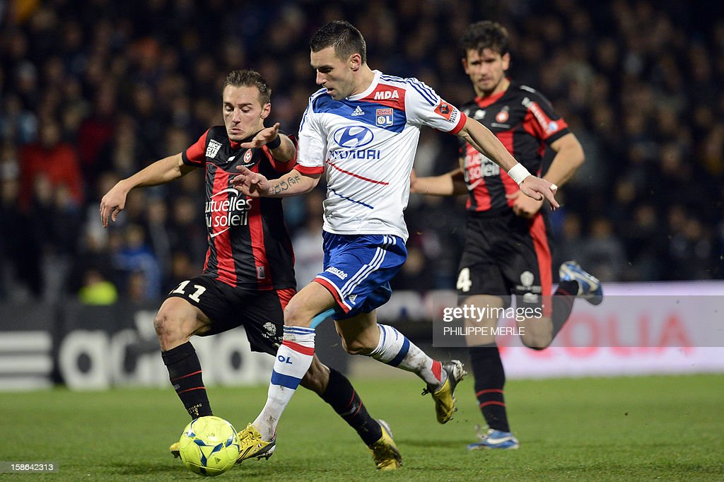 Lyon's French forward Anthony Reveillere (C) vies for the ball with Nice's French forward Eric Bautheac during the French L1 football match Lyon vs Nice on December 22, 2012, at the Gerland stadium in Lyon.