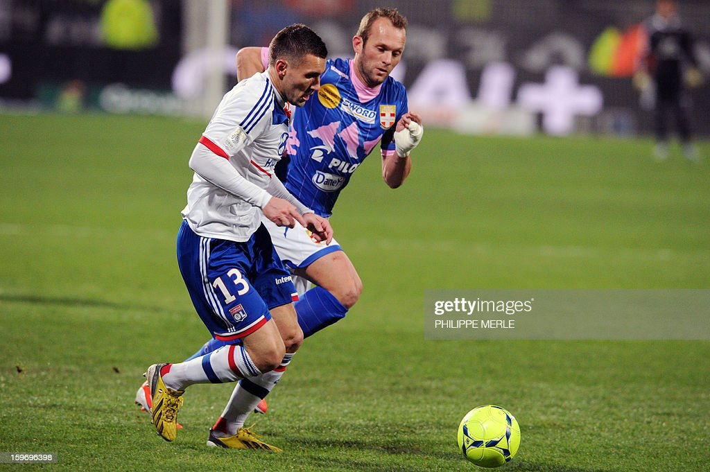Lyon's French forward Anthony Reveillere (L) vies with Evian's French midfielder Olivier Sorlin during the French L1 football match Lyon (OL) vs Evian (TG) on January 18, 2013 at the Gerland stadium in Lyon.