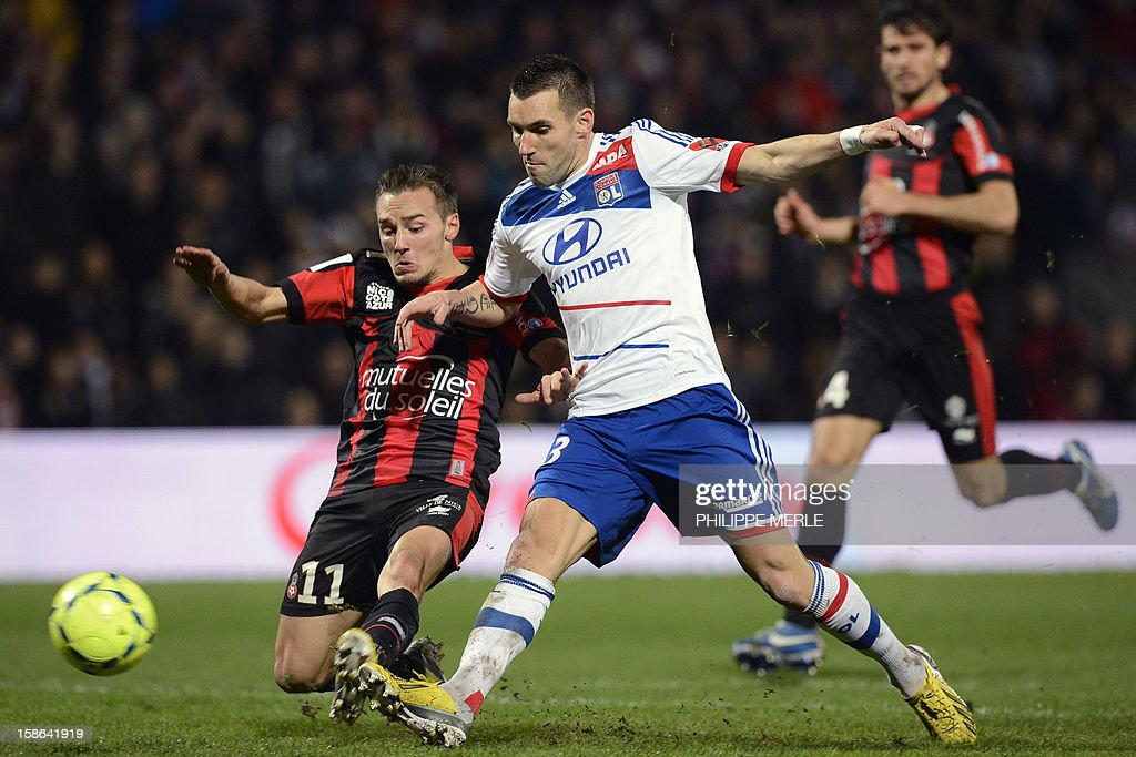 Lyon's French forward Anthony Reveillere (R) vies with Nice's French forward Eric Bautheac before scored a goal during the French L1 football match Lyon vs Nice, on December 22, 2012 at the Gerland stadium in Lyon, central eastern France.