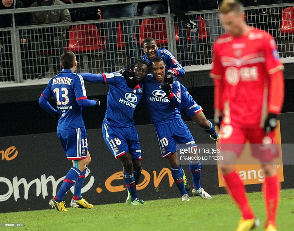 Lyon's French forward Bafetimbi Gomis (C) celebrates with teammates after scoring during the French L1 football match Valenciennes vs Olympique lyonnais at the stadium 'stade du hainaut' in Valenciennes on January 25, 2013.