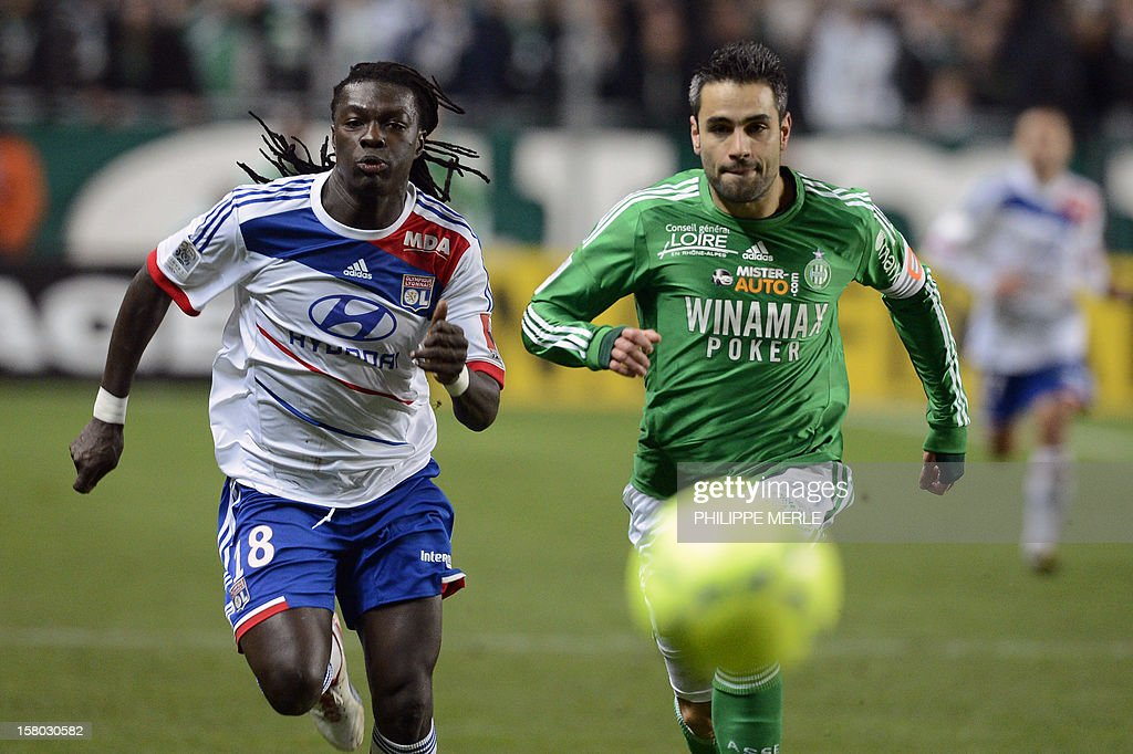 Lyon's French forward Bafetimbi Gomis (L) fights for the ball with Saint-Etienne's French defender Loic Perrin during the French L1 football match Saint-Etienne vs Lyon on December 9, 2012 at the Geoffroy-Guichard stadium in Saint-Etienne.