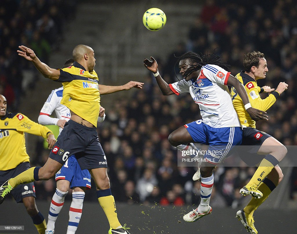 Lyon's French forward Bafetimbi Gomis (2nd R) heads the ball during the French L1 football match Lyon vs Sochaux on March 31, 2013 at the Gerland stadium in Lyon, southeastern France.