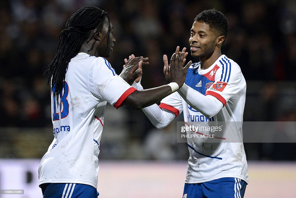 Lyon's French forward Bafetimbi Gomis (L) is congratulated by his teammate Lyon's Brazilian midfielder Michel Fernandes Bastos, after he scored a goal during the French L1 football match Lyon vs Nice, on December 22, 2012 at the Gerland stadium in Lyon, central eastern France.