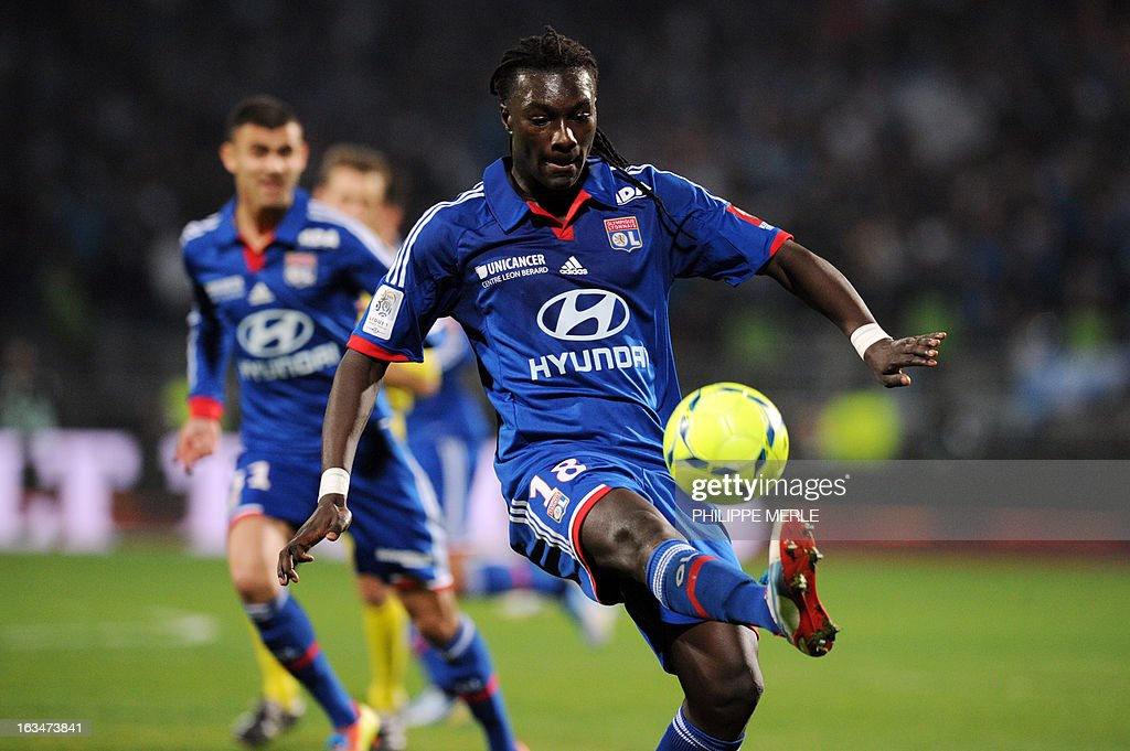 Lyon's French forward Bafetimbi Gomis kicks the ball during the French L1 football match Lyon vs Marseille March 10 , 2013 at the Gerland stadium in Lyon.