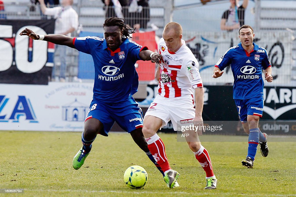 Lyon's French forward Bafetimbi Gomis (L) vies with Ajaccio's French defender Matthieu Chalme during the French L1 football match Ajaccio (ACA) vs Lyon (OL) at the Francois Coty stadium in Ajaccio, on February 3, 2013.