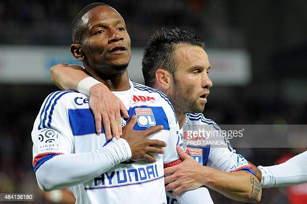 Lyon's French forward Claudio Beauvue is congratulated by Lyon's French midfielder Mathieu Valbuena after scoring a goal during the French L1...