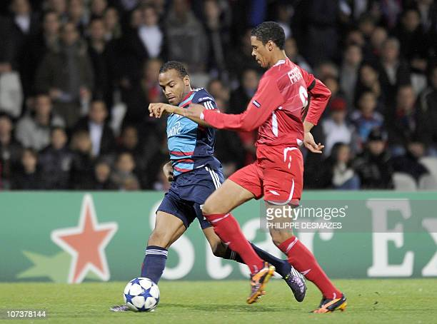 Lyon's French forward Jimmy Briand fights for the ball with Tel Aviv's South African defender Bevan Fransman during the Champions League football...