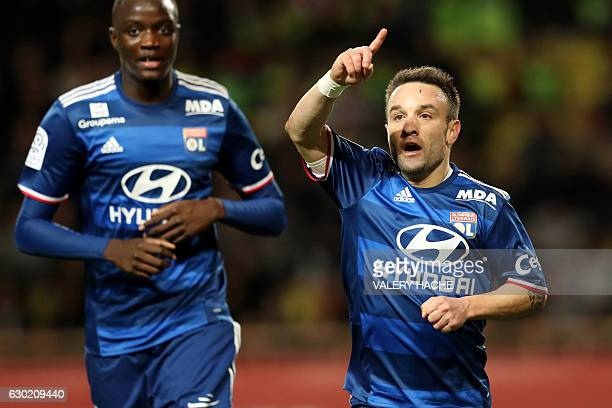 Lyon's French forward Mathieu Valbuena celebrates after scoring a goal during the French L1 football match between AS Monaco and Lyon at the Louis II...