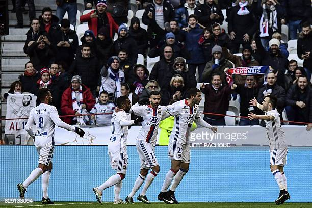 Lyon's French forward Mathieu Valbuena celebrates with his teammates after scoring a goal during the French L1 football match Olympique Lyonnais vs...