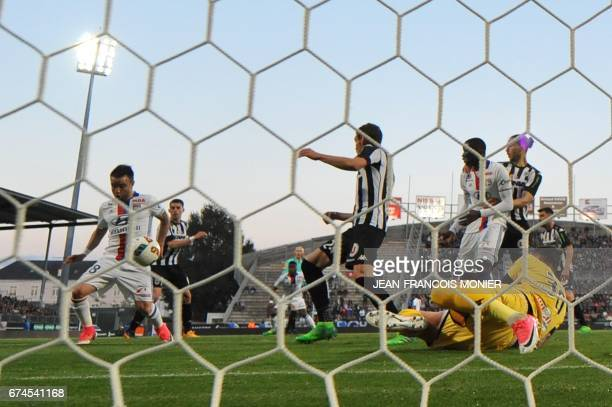Lyon's French forward Mathieu Valbuena scores past Angers' French goalkeeper Alexandre Letellier during the French L1 football match between Angers...