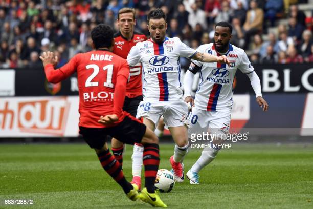 Lyon's French forward Mathieu Valbuena vies with Rennes' French midfielder Benjamin Andre during the French L1 football match between Rennes and Lyon...