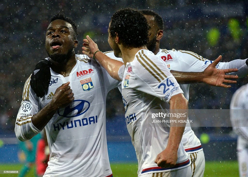 Lyon's French forward Maxwel Cornet (L) celebrates after scoring a goal during the French L1 football match between Lyon (OL) and Gazelec Ajaccio (GFCA) at the Parc Olympique Lyonnais stadium in Decines-Charpieu, central-eastern France, on April 30, 2016.